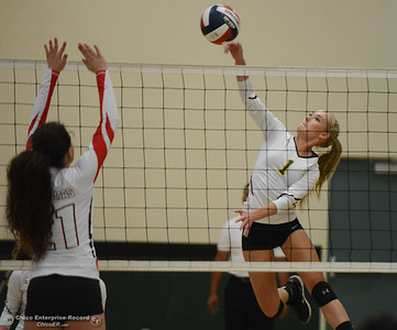 Paradise High's Abby Baber spikes the ball past Las Plumas's Kanoe Salvia in the Northern Section Division III first-round playoff match Wednesday November 1, 2017 in Paradise, California. (Emily Bertolino -- Enterprise-Record)