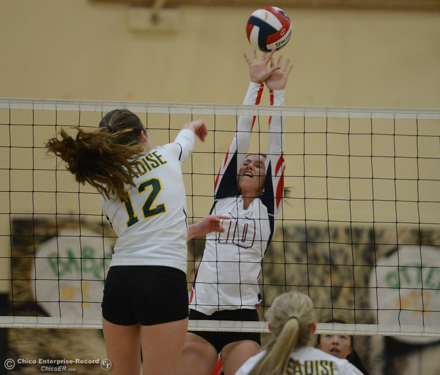 . Las Plumas\'s Kami Barrett goes up to block Paradise High\'s Carly Otten spike in the Northern Section Division III first-round playoff match Wednesday November 1, 2017 in Paradise, California. (Emily Bertolino -- Enterprise-Record)