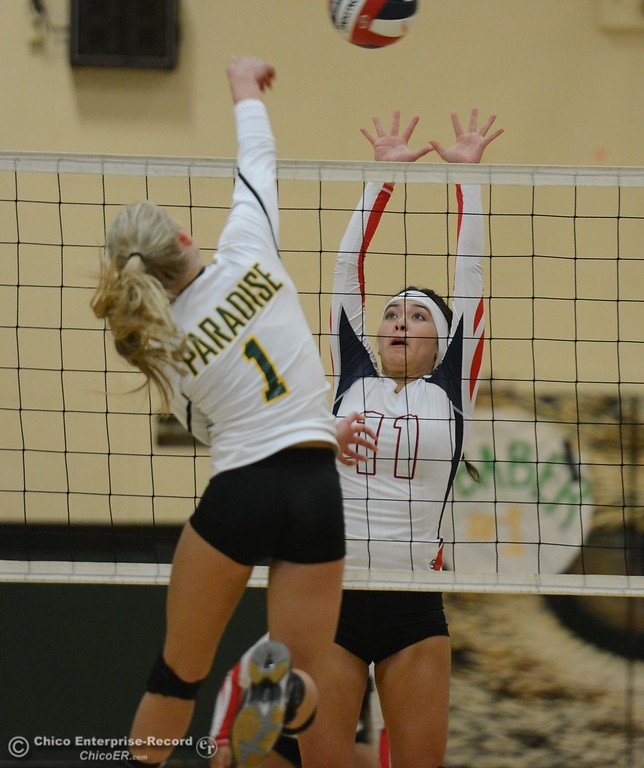 . Las Plumas\'s Megan Mah tries to block Paradise High\'s Abby Baber\'s shot in the Northern Section Division III first-round playoff match Wednesday November 1, 2017 in Paradise, California. (Emily Bertolino -- Enterprise-Record)