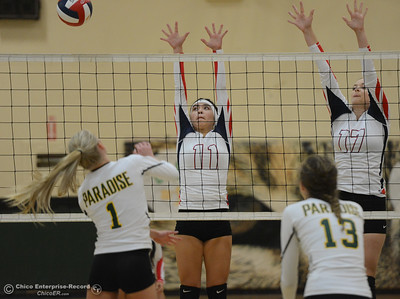 Las Plumas's Megan Mah (11) and Madison Hatley (17) go up for the block against Paradise High's Abby Baber in the Northern Section Division III first-round playoff match Wednesday November 1, 2017 in Paradise, California. (Emily Bertolino -- Enterprise-Record)