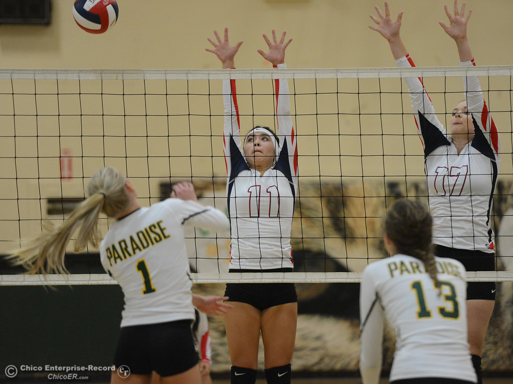 . Las Plumas\'s Megan Mah (11) and Madison Hatley (17) go up for the block against Paradise High\'s Abby Baber in the Northern Section Division III first-round playoff match Wednesday November 1, 2017 in Paradise, California. (Emily Bertolino -- Enterprise-Record)