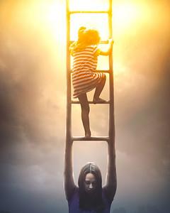 Mother helping Daughter climb