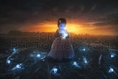 Little girl and light bulb