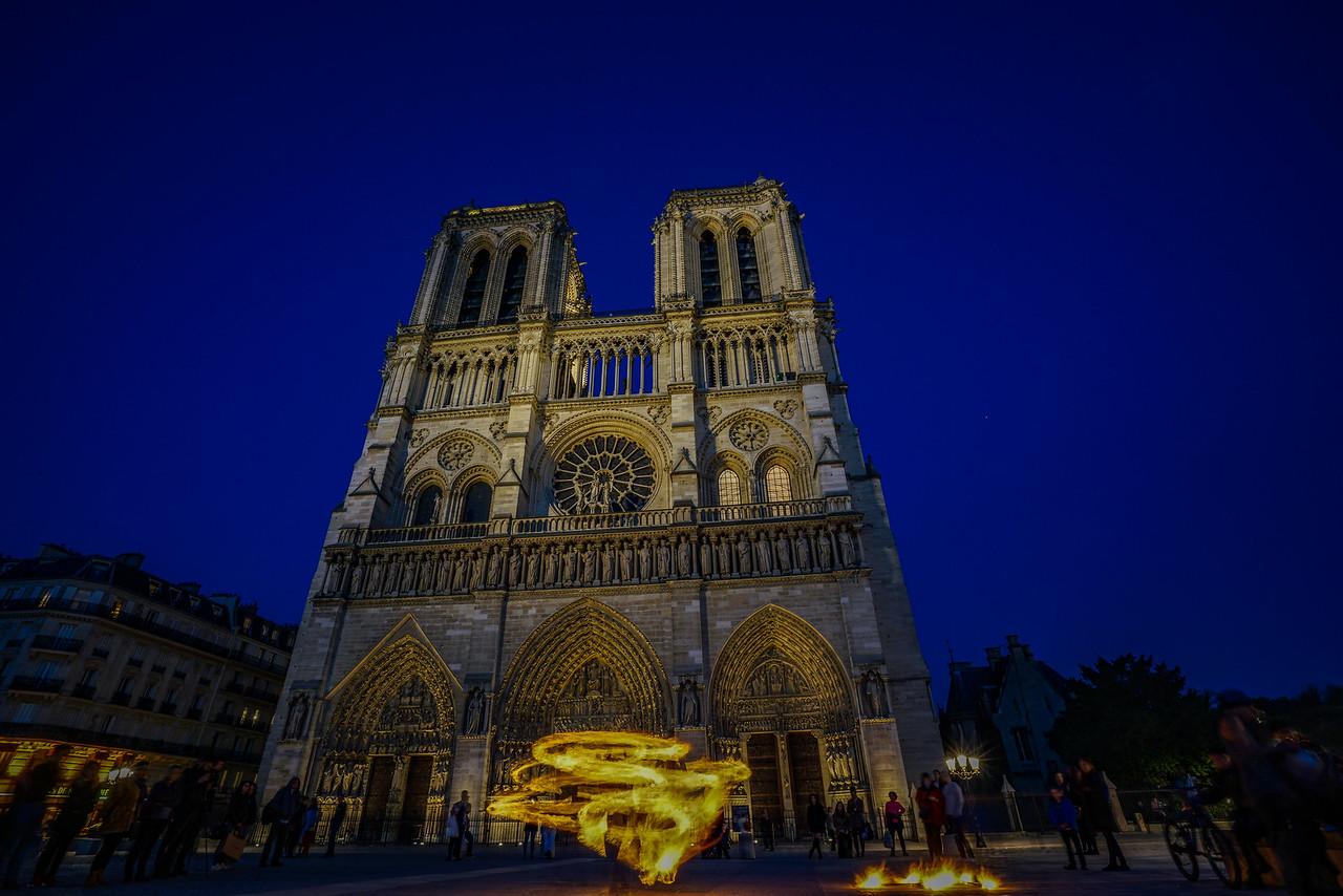 Fire dancer at Notre Dame