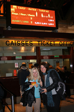 Cathy and Yvonne buying tickets for the Eiffel Tower