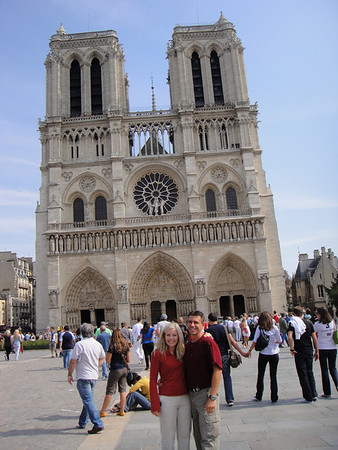 Cathy and Tony standing in front of Notre Dame on a Sunday morning.  Church services are being held inside at this very moment.