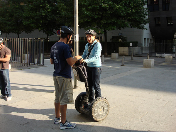 Andrew showing Cathy how to ride a Segway