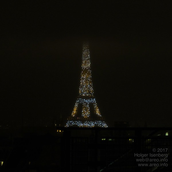 La tour Eiffel in flickering Christmas decoration once every hour or so. View from the terrace on Centre Pompidou.