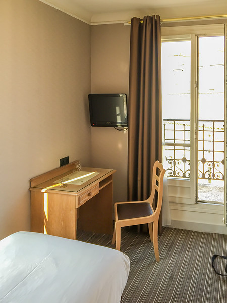 I stepped into the very small room and was immediately thrilled at what I saw.  Keep in mind, I know a lot of people who would NOT be happy with such a room, but it exceeded my expectations and would turn out to be near perfect for my stay in Paris.  :-)