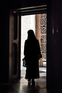 Nun Exiting Notre-Dame Cathedral