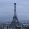 A close-up of the Eiffel Tower from the Arc de Triumph.