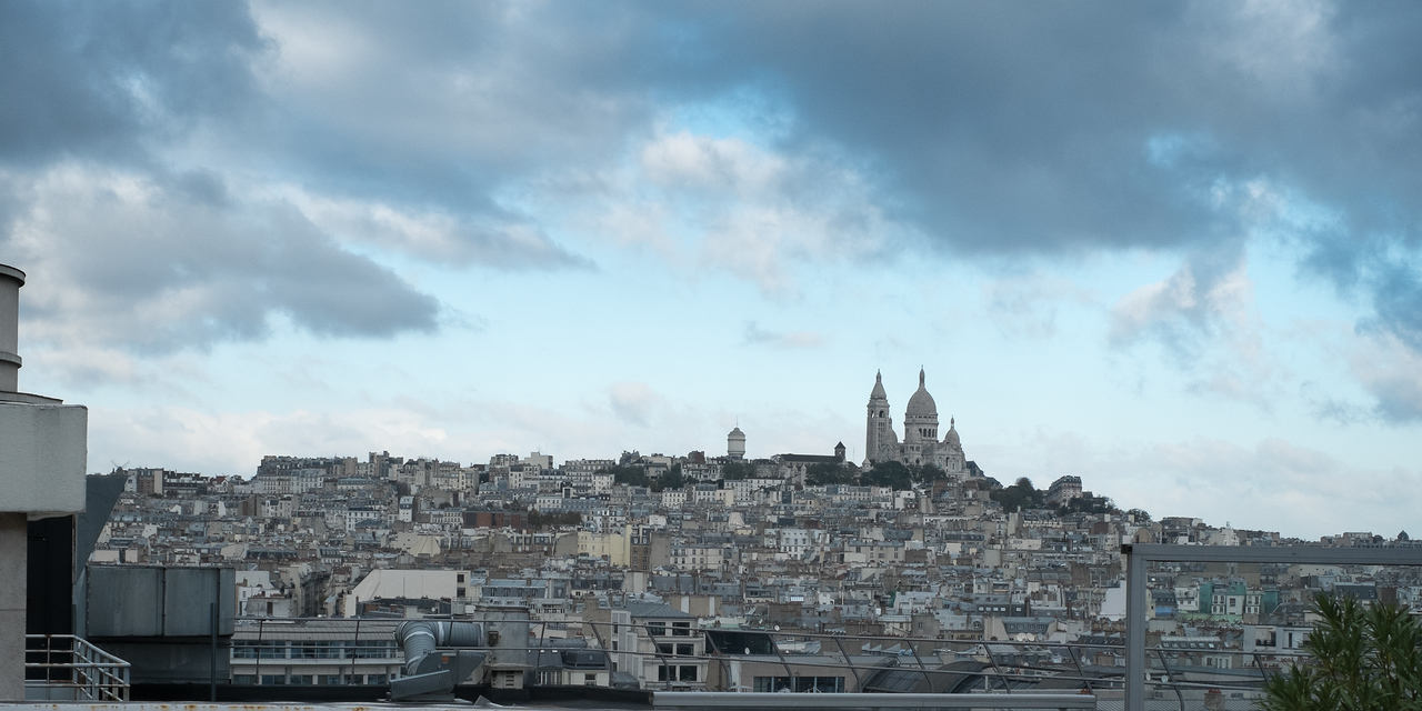 From the roof, the Montmartre area is at the highest point in Paris.  The Church Sacre-Coeur dominates the view.