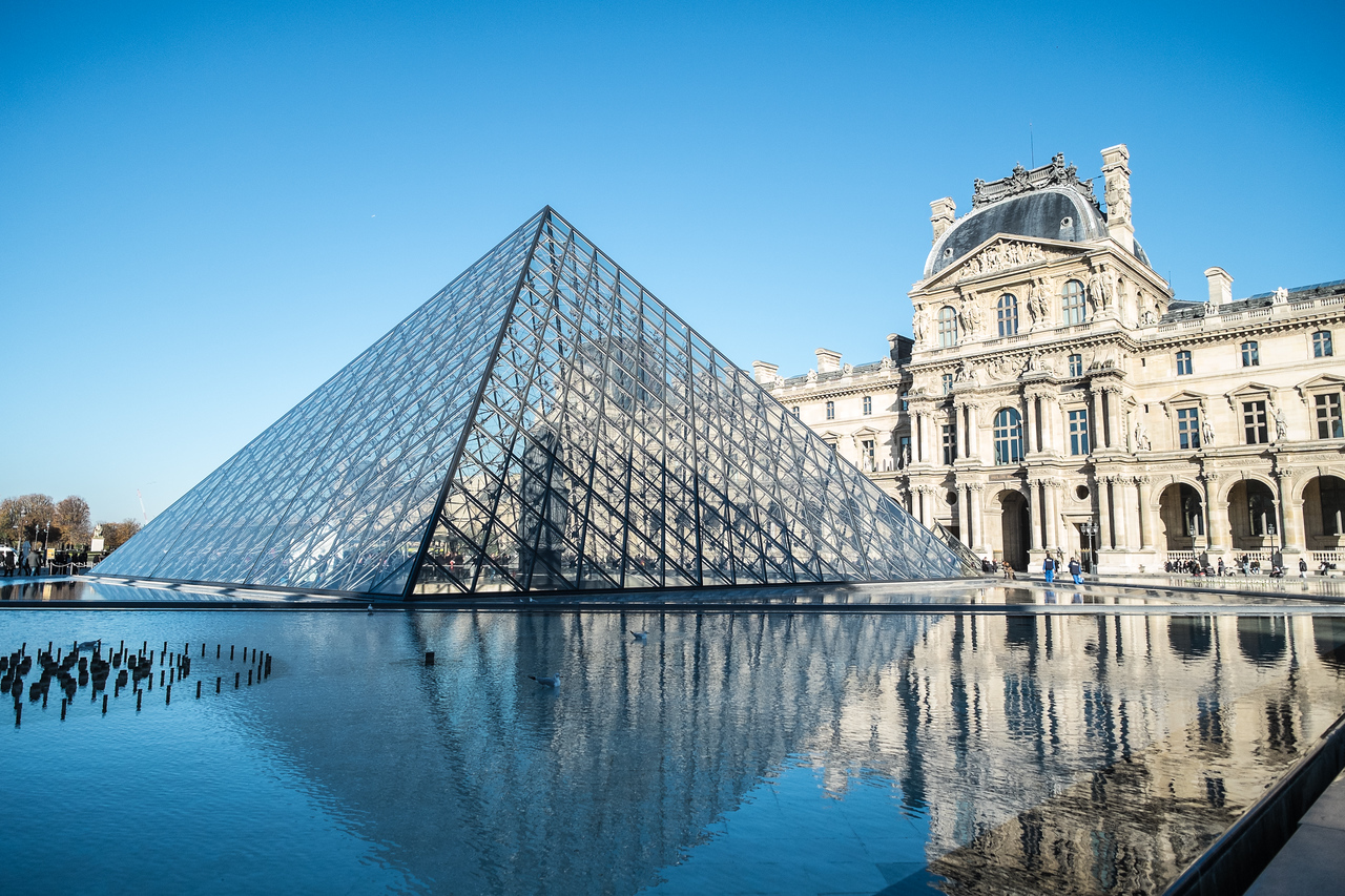 The Louvre Palace was begun in 1682, and was enlarged over time. It opened as a museum in 1793. The Pyramids were added in 1989.