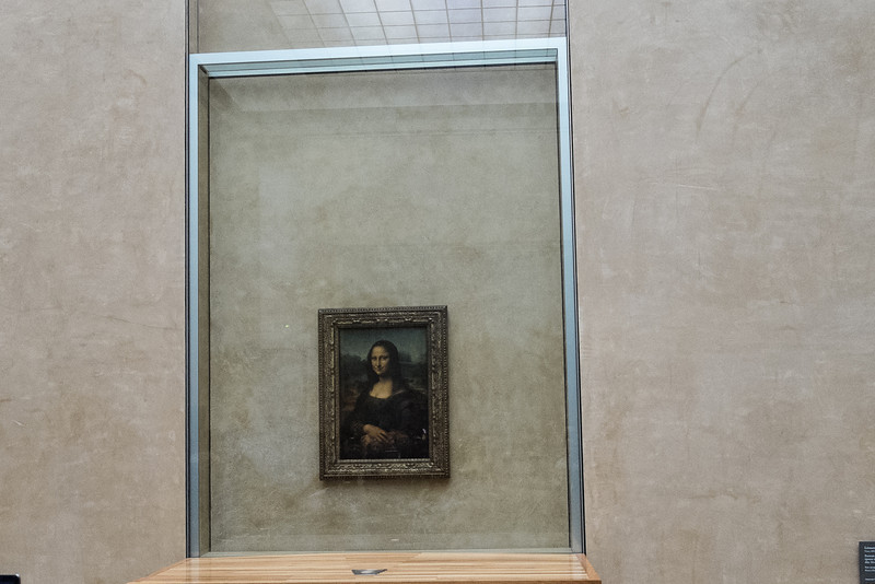 Leonardo da Vinci's Mona Lisa. Behind glass, behind a barrier, and behind a crowd of people.  The most popular exhibit I'd guess.