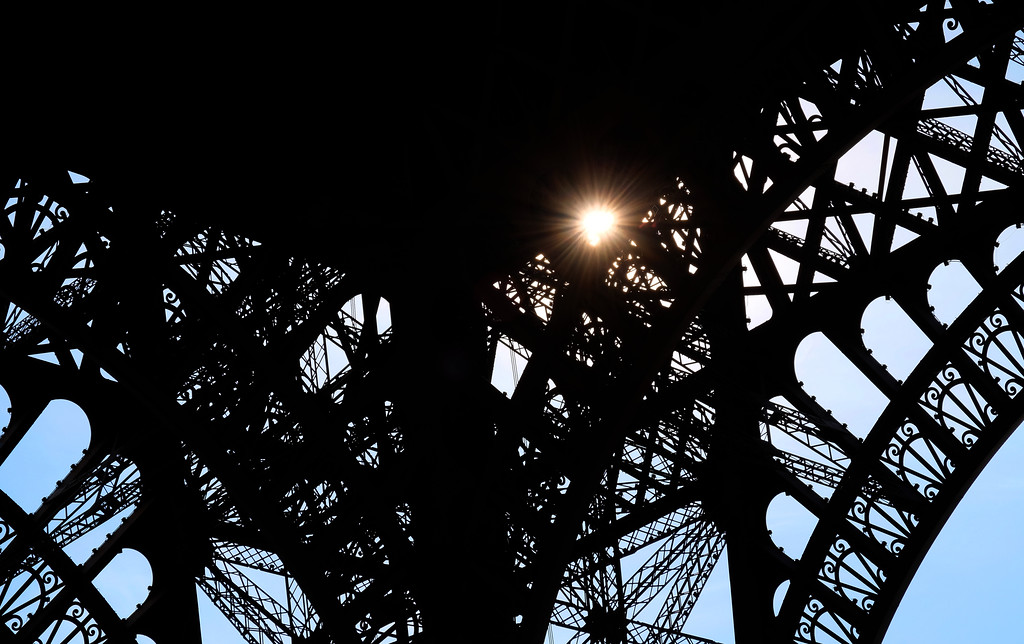 . Afternoon sunlight shines through the Eiffel Tower. Photo by Shmuel Thaler