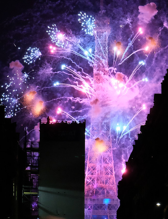 . Bastille Day fireworks light up the sky above the Eiffel Tower as seen from Place de Mexico in Paris on July 14, 2018, our first night in the \'City of Light\'. Photo by Shmuel Thaler