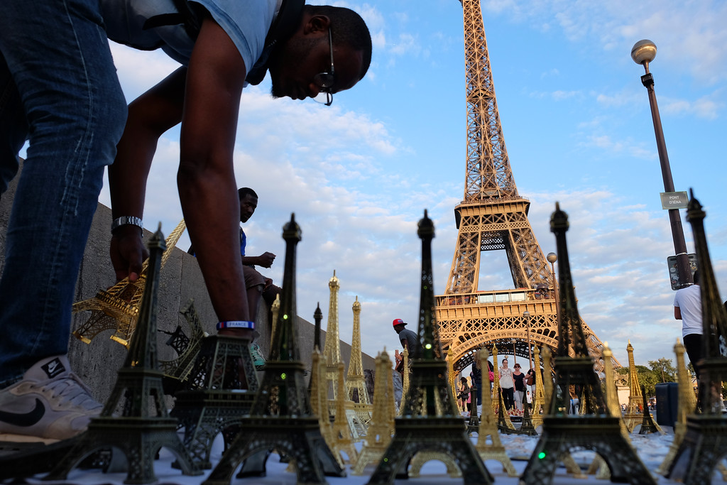 . A vender sells Eiffel Tower models not far from the actual landmark in paris. Photo by Shmuel Thaler