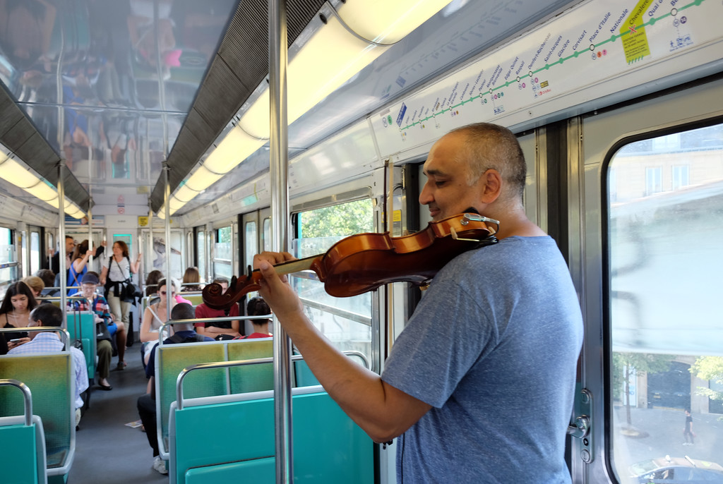 . Violinist on the number 6 train of the Paris Metro. Photo by Shmuel Thaler