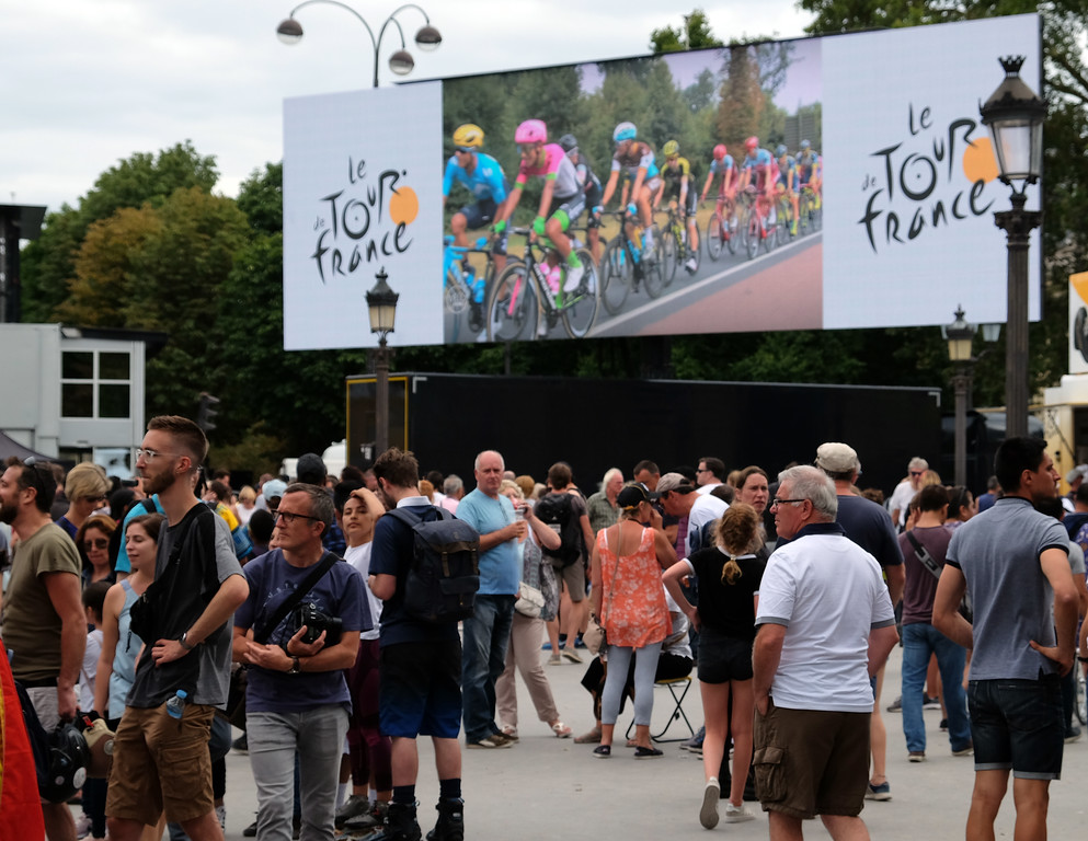 . Spectators await the Tour de France riders to arrive in Paris during the final stage of the bike race. Photo by Shmuel Thaler