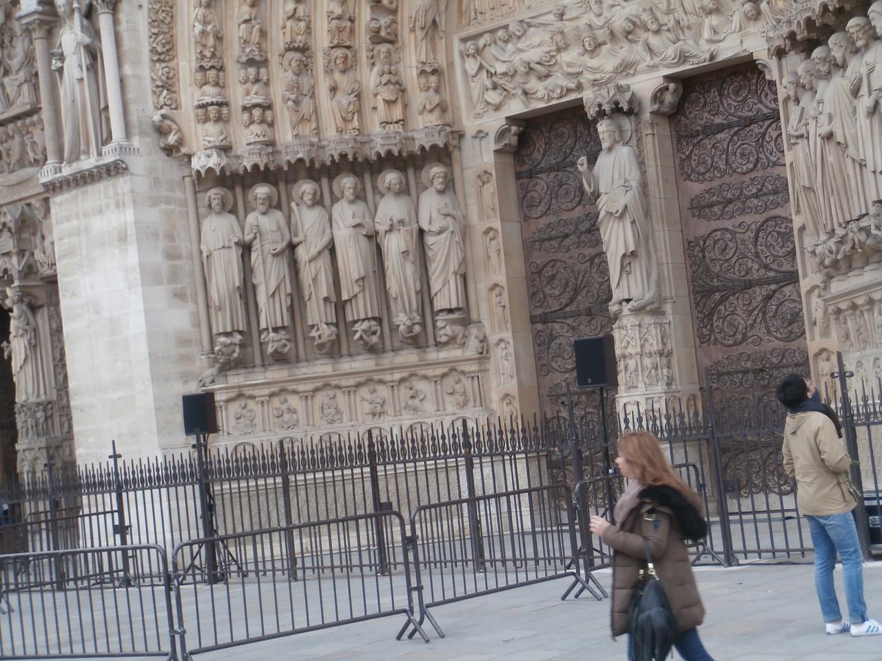 More saints standing at the door