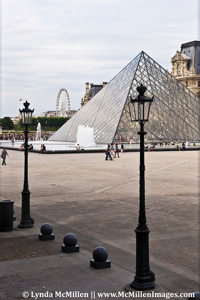 Glass pyramid entrance in the palace's center courtyard.