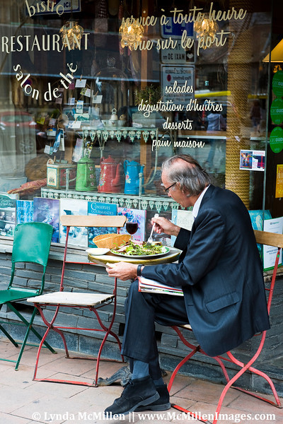Quintessential frenchman enjoying lunch at outdoor cafe.