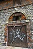 Fleeing figure on door to 1670 warehouse formerly used to store salt.