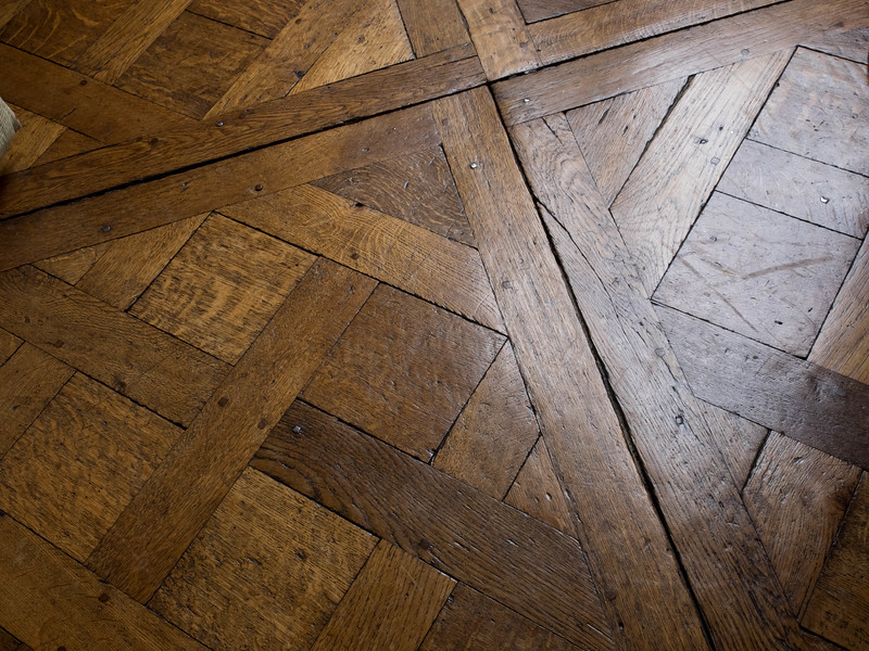 Floor in Tina and Paige's apartment.  Some of the nails are wooden.