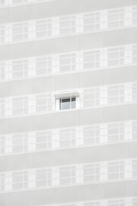 A window on the facade of the 10 Grenelle building in Paris