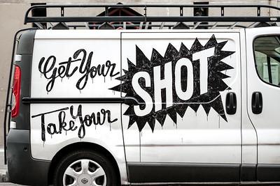 A white minivan with a graffiti in Paris