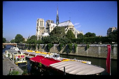 Classic Notre Dame with colorful river traffic