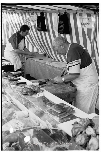 Cutting meat in the Market Monge.