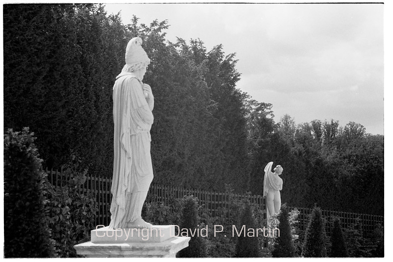 Statues at Versailles. Credit belongs to Robert Doisneau who first photographed this juxtaposition - or did he copy someone else?