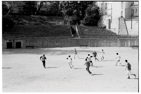 Playing football (soccer) in a Roman arena in the heart of Paris.