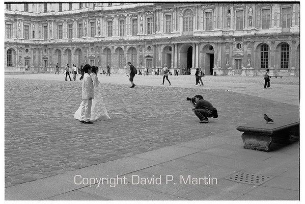 Wedding pictures in the courtyard of the Louvre.