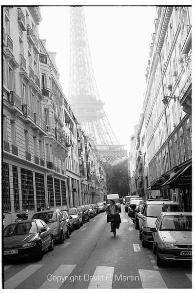 The Eiffel tower as seen from a side street.