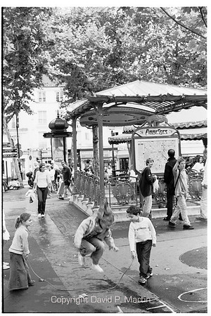 Jumping rope at the Metro stop Abbesses.