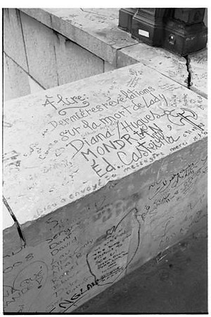 Messages on the stonework near the Flame of Liberty.
