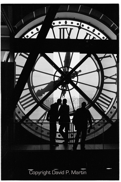 One of two clocks on the front of the Museum d'Orsay.