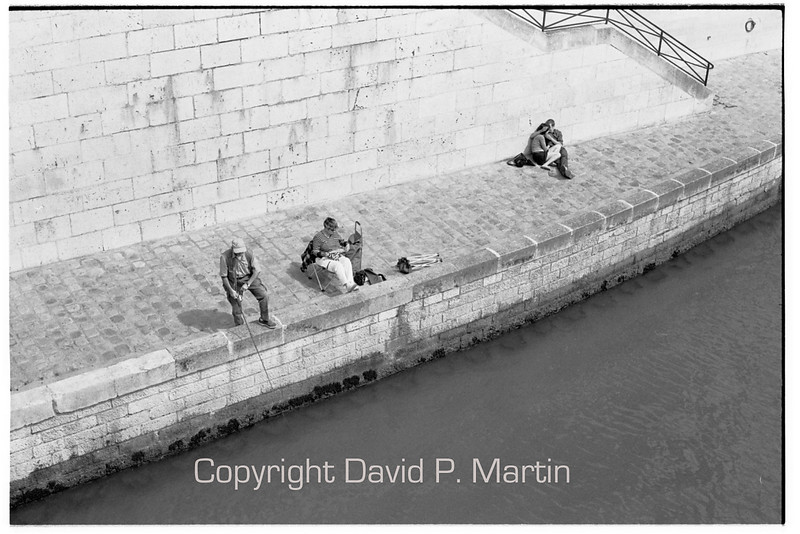 Fishing, knitting, and enjoying the Seine.