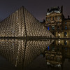 Reflection of the Lourve Museum at night.