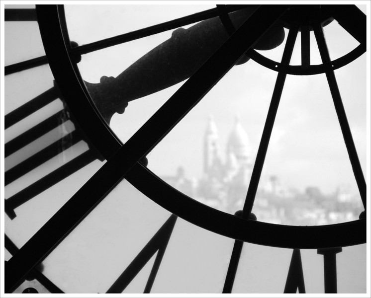 Sacre Coeur viewed through clock on top floor of the D'Orsay Museum. Paris, 2013.