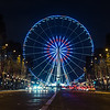 View of the Big Wheel from Champs-Elysees Avenue at night.