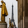 Golden statues and Eiffel Tower.