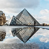 Reflection of the Lourve Museum Pyramid.