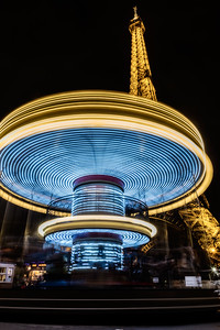 Carousel and Eiffel Tower at night.