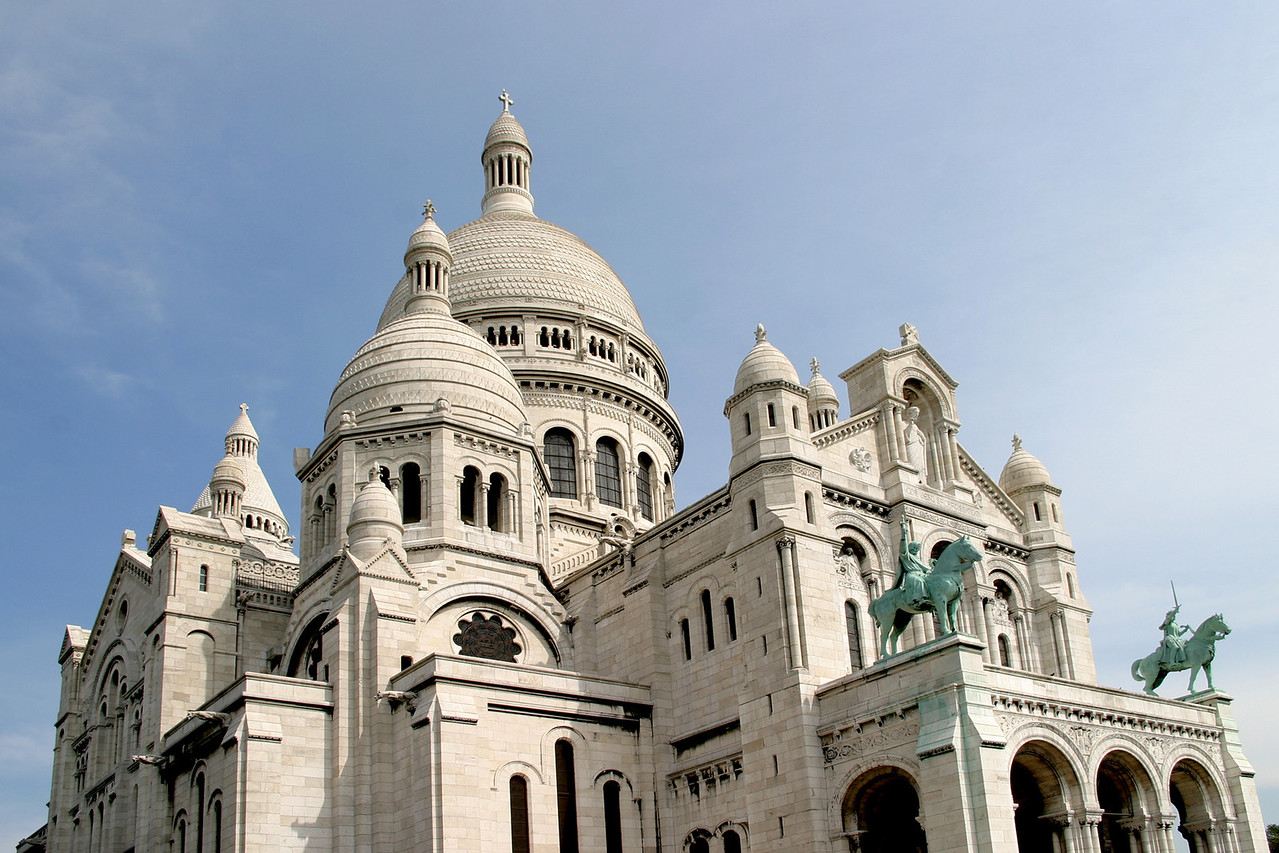 Basilique du Sacré-Cœur, Paris more commonly known as the Sacré-Cœur Basillica. It is s a Roman Catholic church and minor basilica, dedicated to the Sacred Heart of Jesus (peace be upon him) and is located at the summit of Montmartre. You can climb stairs to the top - lots of stairs but great views from the dome.