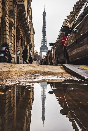 Reflection of Eiffel Tower on a side walk.