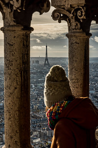 Admiring Eiffel Tower from the dome of Sacre-Coeur de Montmartre.