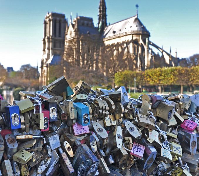 Love Locks on the Pont de l'Archevêché with Notre Dame behind. 2017.